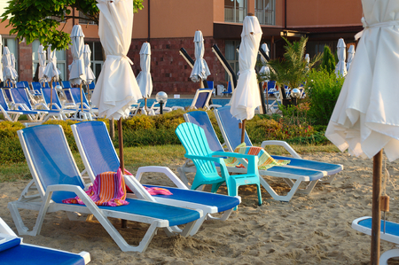 Lots empty sun loungers Stock Photo