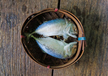 Steamed Mackerel fish on bamboo wicker basket photo