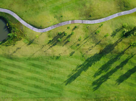 Aerial view of the green golf course in Thailand. Stock Photo