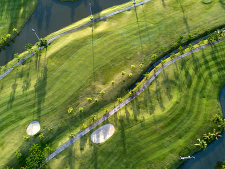 conquering adversity: Aerial view of the green golf course in Thailand. Stock Photo