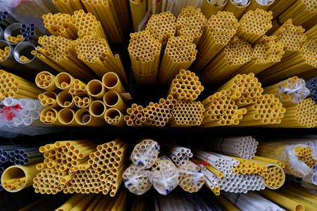 ferrous: Yellow pipe for Electric in warehouse.