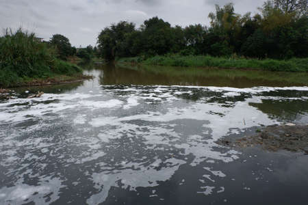 Water pollution flow to main river in Asia. Stock Photo