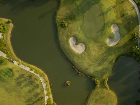 Aerial view of the green golf course in Thailand. 版權商用圖片