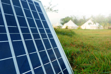 Solar panels or Solar cells energy and tents camping. Banque d'images
