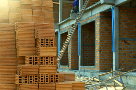 Red bricks for building in construction site.