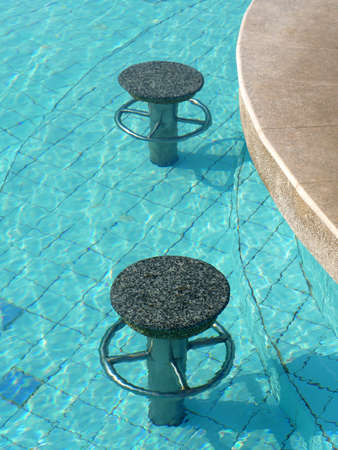 Bar Stools under water in Swimming pool. Archivio Fotografico