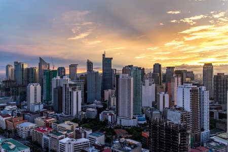 sunrise in the makati city , philippines