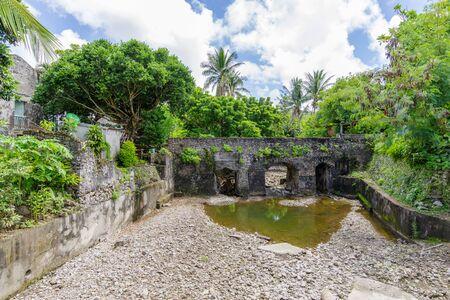 Spanish style old stone bridge at Batan Island, Batanes, Philippines Stock Photo - 87851738