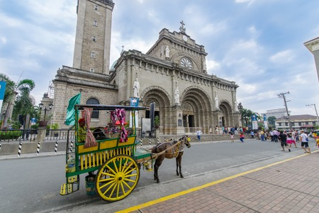 Feb 21,2018 Wagons waiting for tourists in front of Manila Cathedral, Manila , Philippines Editorial