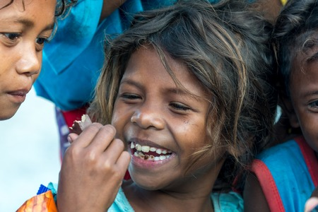 Feb 18, 2018 Aeta child happy to eat chocolate bar, Capas, Philippines