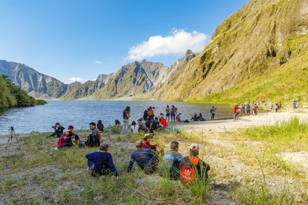 Feb 18,2018 Tourists and guides taking a break in front of Mt. Pinatubo crater lake, Capas, Philippines Editorial