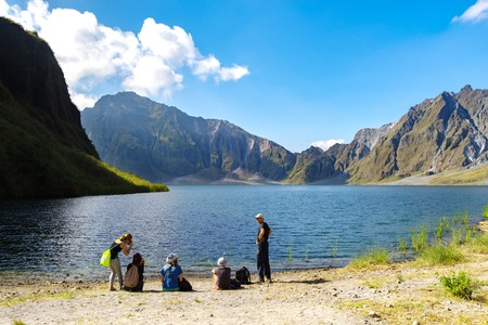 Feb 18,2018 Tourists taking a break in front of Mt. Pinatubo crater lake, Capas, Philippines