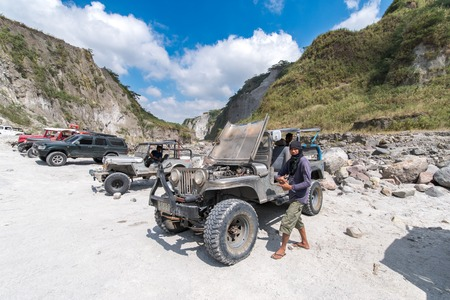 Feb 18, 2018 Four-wheel drive cars parked at the start of the Pinatubo hike, Capas , Philippines Editorial