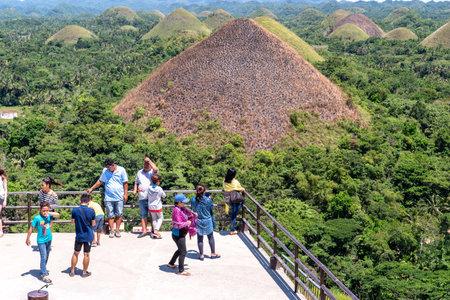 Bohol island, Philippines. Apr 23, 2018 : Tourists enjoying Chocolate Hill Redakční