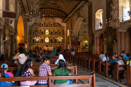 Cebu city, Philippines Apr 25,2018 - People praying in the Sto Nino Church