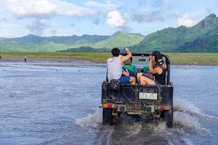 CAPAS , PHILIPPINES - July 8, 2018 : Tourists on a Mt. Pinatubo tour by car