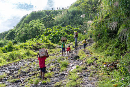 CAPAS , PHILIPPINES - July 8, 2018 : Aeta people going to town with their luggage