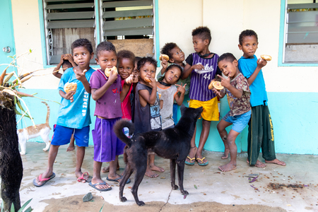 CAPAS , PHILIPPINES - July 8, 2018 : Aeta children eating bread