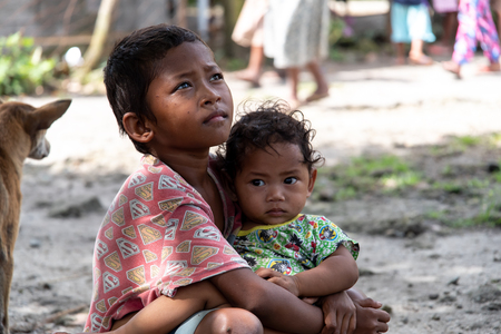 CAPAS , PHILIPPINES - July 8, 2018 : Aeta boy holding his brother