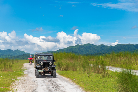 CAPAS , PHILIPPINES - July 8, 2018 : Tourists on a Mt. Pinatubo tour by car Editorial