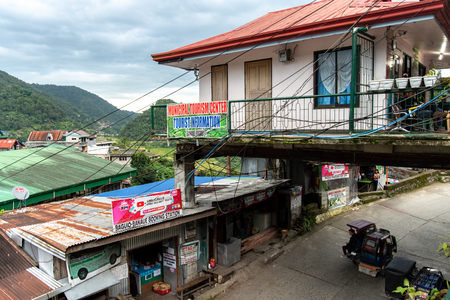 BANAUE PHILIPPINES, Aug 22, 2018 Tricycle passing through tourist information center Editorial