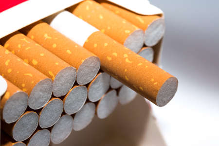 A pack of cigarettes at white background
