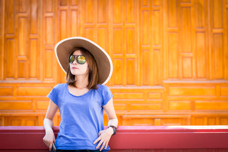 Relax and freetime with young woman wearing hat enjoying stand on balcony in the house.