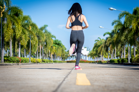 Woman jogging outdoor workout on park. Stock Photo