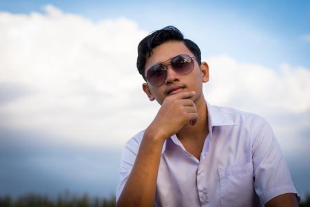 Man sitting on a pier.