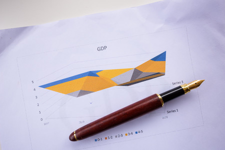 GDP words on the paper with a pen. Imagens