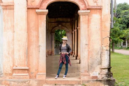 Backpacker or hiker visiting ancient buildings.