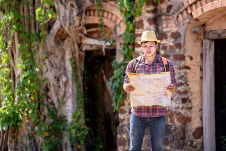 Backpackers or hikers are reading maps in ancient places.