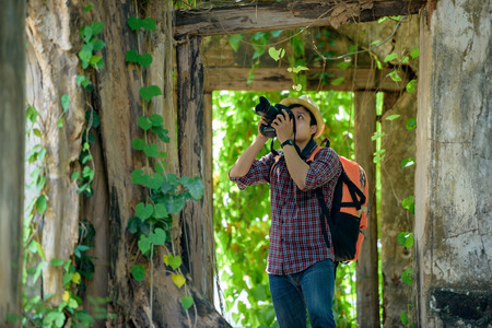 Backpackers or hikers Photography with digital SLR camera in ancient places. Stock Photo