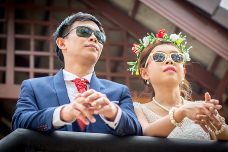 Beautiful Young wedding couple standing on balcony.