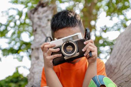 boy with camera retro