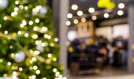 Colorful christmas tree light bokeh and blured in shopping mall Stock Photo