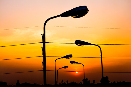 Silhouette Electric Lamp Whith Sunset