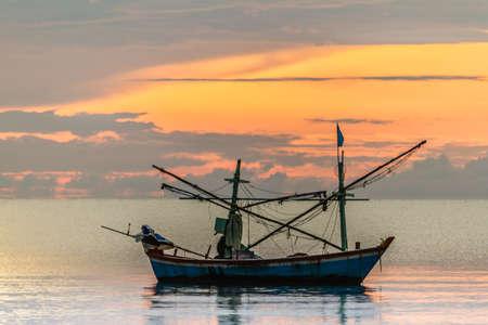fisherman boat: Boat at sunrise