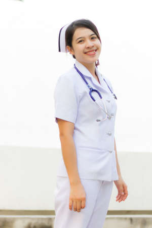 Nurse smiling with stethoscope photo