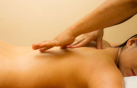 Woman on spa massage of body in the beauty salon.  Stock Photo