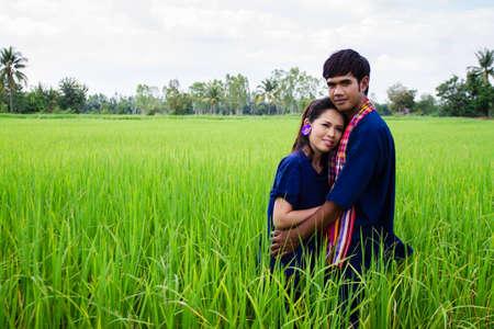 Couple farmer in farmer suit on rice fields  photo