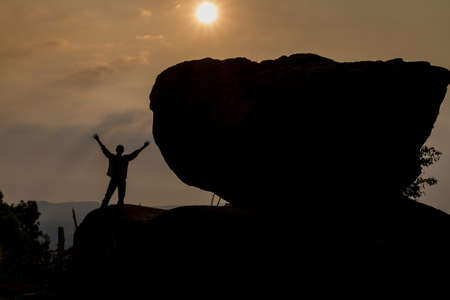 praying man: Praying man silhouette on sunset background