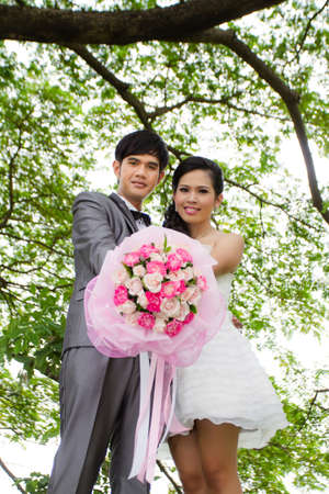 Wedding couple with flower photo