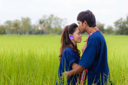 Couple Thai farmer on rice fields photo