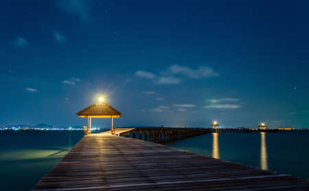 cancun: Wooded bridge in the port at night