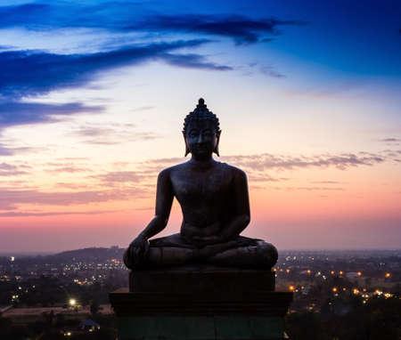 thai monk: Buddha statue in sunset at Phrabuddhachay Temple Saraburi, Thailand.