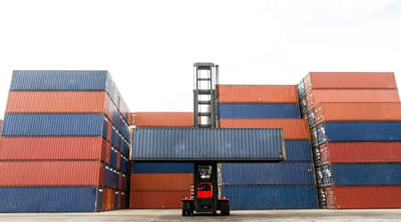 shipping container: Crane lifting up container in yard Stock Photo