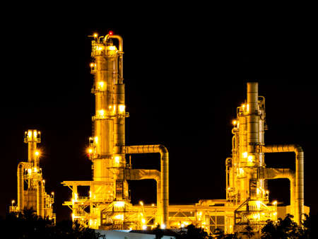 Catalyst: Oil refinery working at night Editorial