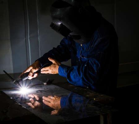Industrial welder welding on steel in factory Stock Photo - 19143531