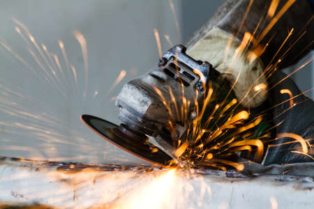 Metal grinding on steel pipe close up  Stock Photo